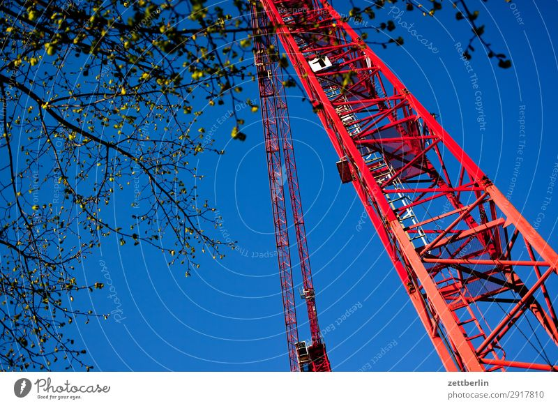 Construction site in spring slewing crane Worm's-eye view Building Commerce Labor union Sky Heaven Blue sky Sky blue Industry Crane Montage