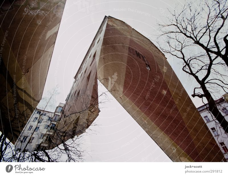 stylish firewall Sky Winter Downtown Berlin Whimsical Surrealism Irritation Change Double exposure Fire wall Backyard Ravages of time GDR Illusion Reaction