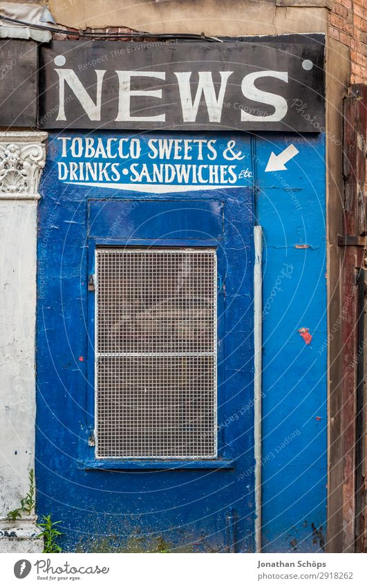 Facade retail shop kiosk Town Architecture Trade England Great Britain leeds Newspaper Tobacco Tobacco products Candy Beverage stall Store premises Kiosk