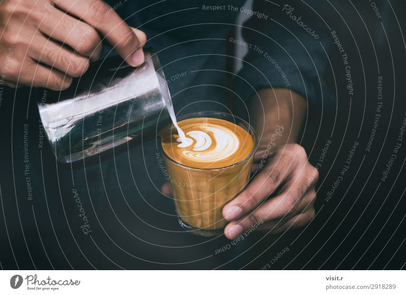 Barista pouring hot milk prepare latte art on cup of coffee Breakfast To have a coffee Beverage Hot drink Coffee Latte macchiato Espresso Cup Mug Lifestyle