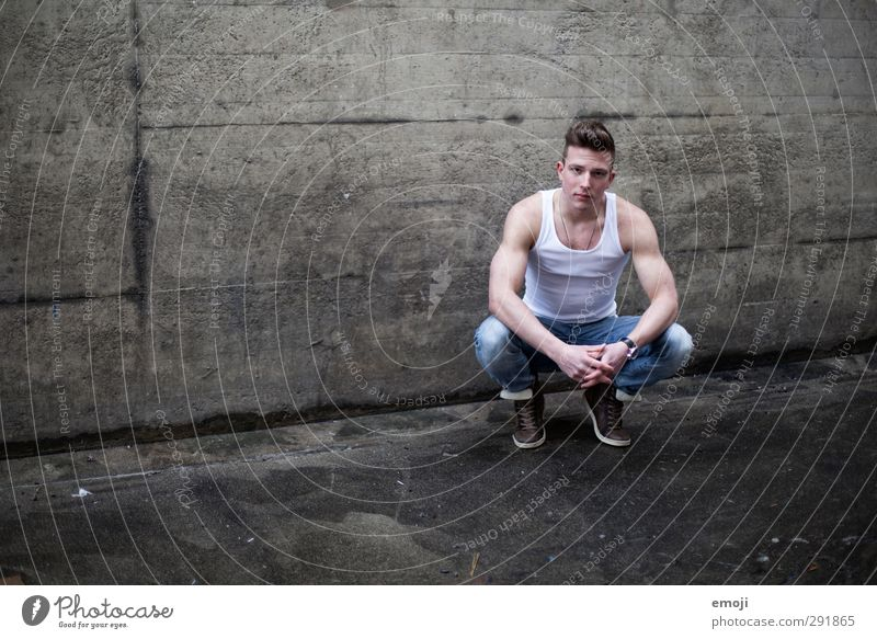 dark grey Masculine Young man Youth (Young adults) 1 Human being 18 - 30 years Adults Wall (barrier) Wall (building) Beautiful Muscular Concrete Sports top