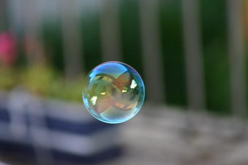 soap bubble Soap bubble Reflection Multicoloured Round Shallow depth of field Air Hover Leisure and hobbies Sphere Flying