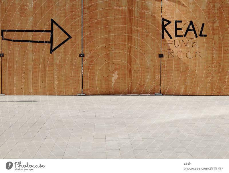 Always on the wall with Real. Town Downtown Deserted Wall (barrier) Wall (building) Facade Wood Sign Signs and labeling Signage Warning sign Arrow Brown Really
