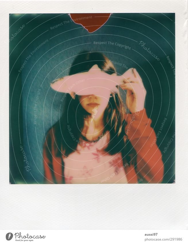 Am I fish? Polaroid Fish Trout Eating Dazzle Perspective Eyes Portrait photograph Child Girl Youth (Young adults) Young woman Protection Closed Anticipated