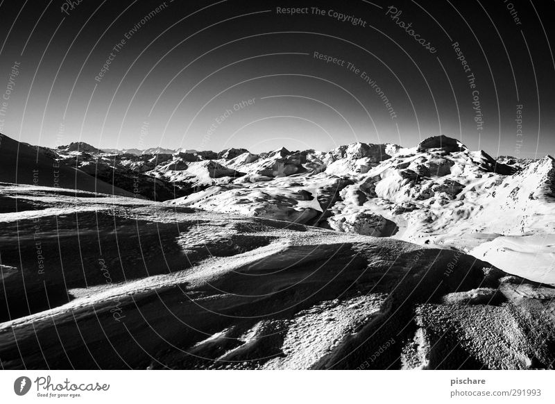 alpine Landscape Winter Snow Mountain Snowcapped peak Dark Adventure Cold Black & white photo Exterior shot Copy Space bottom Day Contrast Sunlight