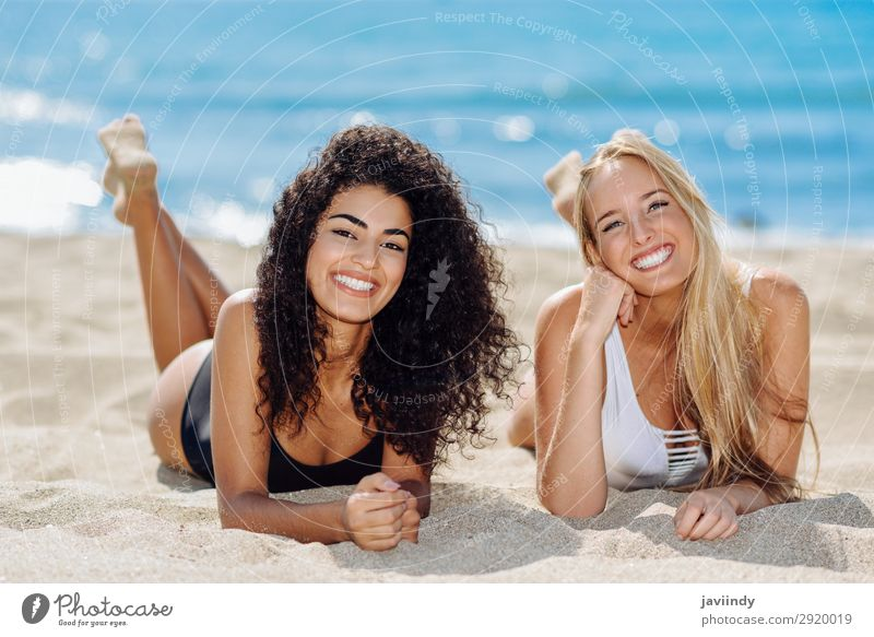 Two young women in swimsuit on a tropical beach Lifestyle Joy Happy Beautiful Body Hair and hairstyles Leisure and hobbies Vacation & Travel Tourism Summer