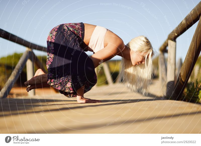 Caucasian female practicing yoga on wooden bridge. Lifestyle Happy Beautiful Body Harmonious Relaxation Meditation Freedom Summer Sun Beach Yoga