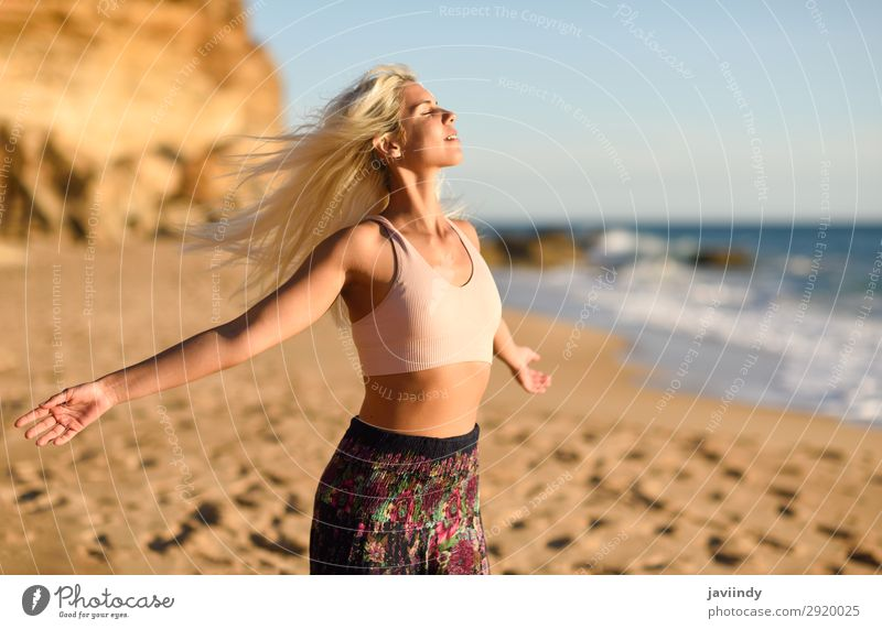 Woman enjoying the sunset on a beautiful beach Lifestyle Happy Beautiful Body Relaxation Leisure and hobbies Vacation & Travel Freedom Summer Sun Beach Ocean