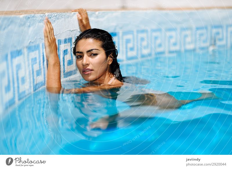 Beautiful Arab woman relaxing in swimming pool. Lifestyle Happy Body Hair and hairstyles Skin Relaxation Swimming pool Leisure and hobbies Vacation & Travel