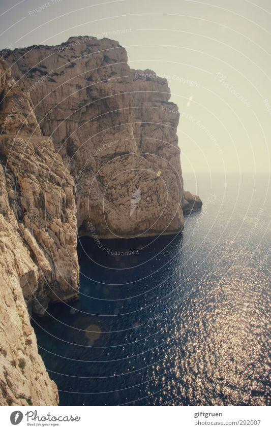 great wide open Environment Nature Landscape Elements Earth Water Sky Cloudless sky Sun Rock Waves Coast Ocean Island Large Sardinia Italy Rocky coastline Steep