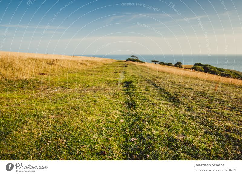 Sky Vacation & Travel Nature Summer White Landscape Ocean Far-off places Environment Meadow Coast Tourism Rock Hiking Field Beautiful weather