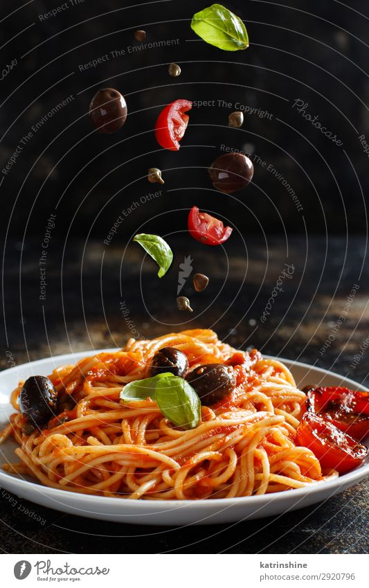 Spaghetti with tomato sauce olives and capers Vegetable Lunch Dinner Vegetarian diet Plate Wood Green Red Tradition pasta puttanesca Olive Basil Tomato Sauce
