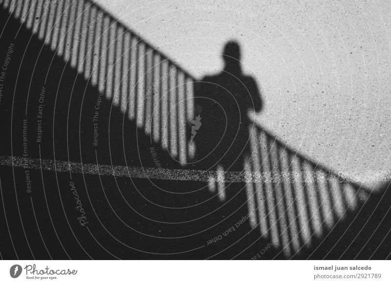 man shadow silhouette on the ground Silhouette Human being Man Shadow Light Sun Sunlight Street Ground Exterior shot City Abstract Minimal Neutral Background