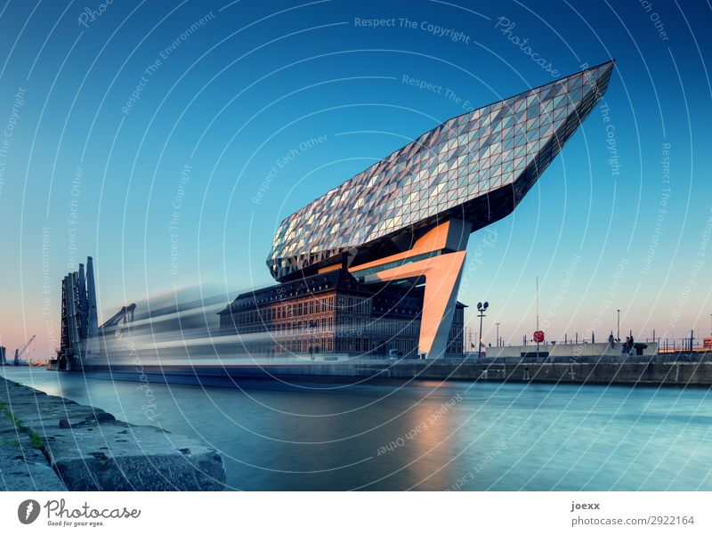 Futuristic port administration building in the port of Antwerp Port Authority The Port House Architecture Long exposure Water Sky Blue Harbour Port City
