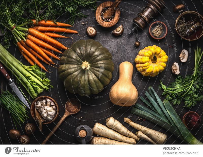 Autumn seasonal food. Colorful various pumpkins and organic farm vegetables. Vegetarian cooking. Thanksgiving or Halloween recipes. autumn colorful dark kitchen