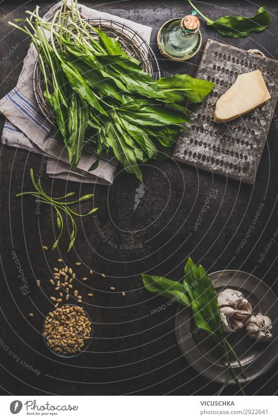 Wild garlic pesto ingredients on dark rustic kitchen table Food Herbs and spices Nutrition Organic produce Vegetarian diet Diet Crockery Style Healthy Eating