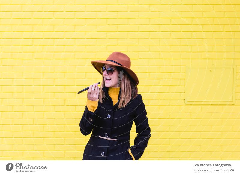young woman outdoors using mobile phone, sending an audio Lifestyle Style Happy Beautiful Telephone PDA Technology Feminine Young woman Youth (Young adults)