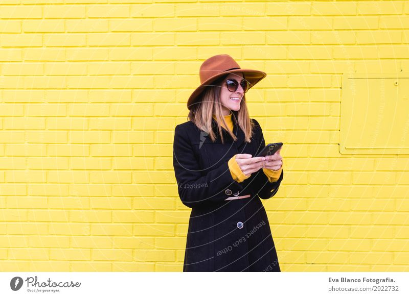 young woman outdoors using mobile phone and smiling Lifestyle Style Happy Beautiful Hair and hairstyles Telephone PDA Technology Human being Feminine