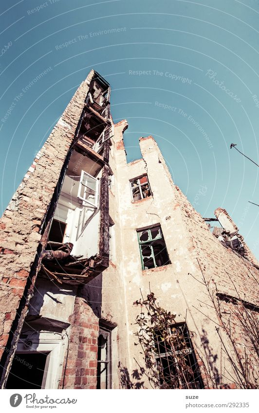 Old houses down to the ground. Environment Sky Ruin Building Architecture Facade Window Stone Exceptional Historic Tall Broken Blue Decline Transience Change