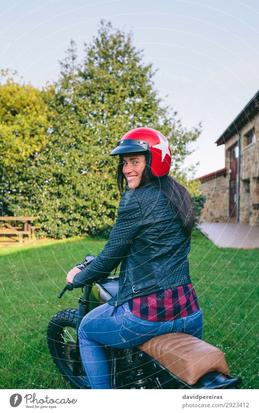 Woman with helmet riding custom motorbike Lifestyle Happy Beautiful House (Residential Structure) Engines Human being Adults Tree Grass Transport Vehicle