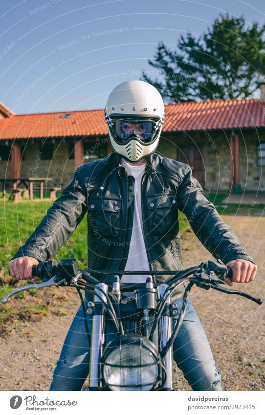 Man with helmet riding custom motorbike Lifestyle House (Residential Structure) Engines Human being Adults Tree Grass Transport Lanes & trails Vehicle