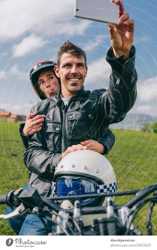 Couple taking a selfie on the motorcycle Lifestyle Joy Happy Vacation & Travel Trip PDA Human being Woman Adults Man Nature Grass Motorcycle Smiling Authentic