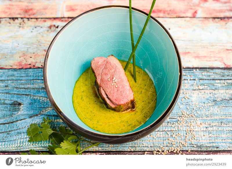 Pink saddle of venison with peas Orange Ginger Sauce Food Meat Vegetable Peas Fusion Nutrition Dinner Buffet Brunch Banquet Business lunch Slow food Plate Bowl