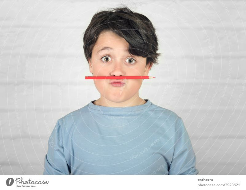 funny child with colored pencil in the mouth Joy Playing Child School Human being Masculine Infancy 1 8 - 13 years Stationery Think To hold on Smiling Write