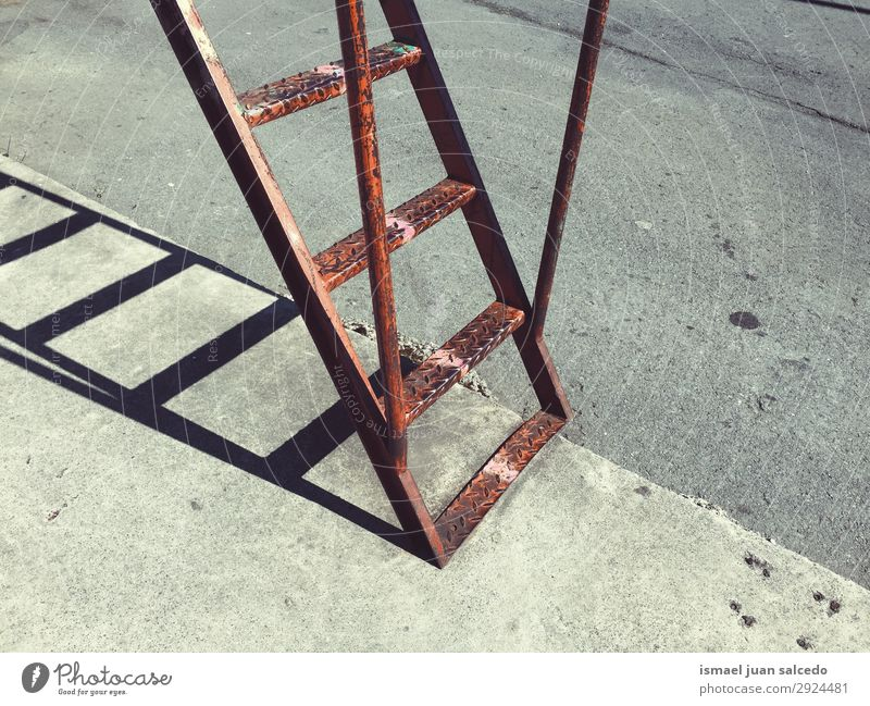 old metallic ladder in the street shadow silhouette Stairs Ladder Old Wall (building) Street Exterior shot Building Objective Metal staircase Stepladder Tool