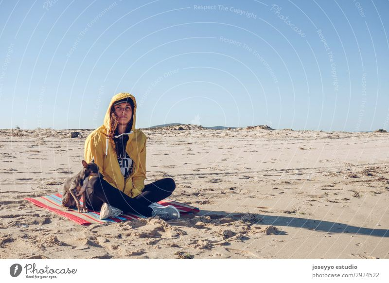 Young and brunette woman with her little dog on the beach Lifestyle Vacation & Travel Tourism Trip Beach Ocean Island Sports Woman Adults 30 - 45 years Nature
