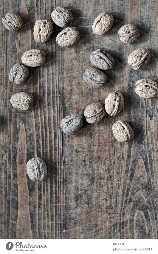 Nuts on the table Food Nutrition Healthy Delicious Walnut Nutshell Table Wood Wooden table Hard Colour photo Subdued colour Close-up Structures and shapes