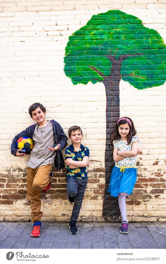Portrait of three kids with a painted tree background Woman Child Human being Vacation & Travel Nature Youth (Young adults) Summer Blue Town Beautiful Green