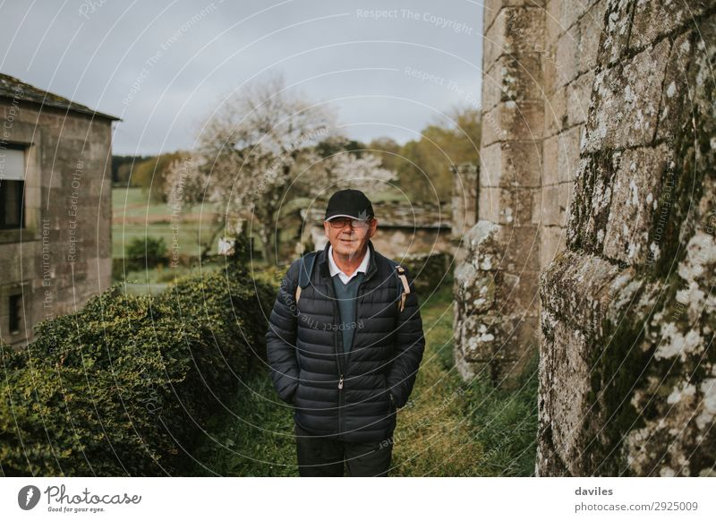Man walking in a rural village Human being Vacation & Travel Nature Old Green Landscape Relaxation Joy Lifestyle Adults Wall (building) Senior citizen