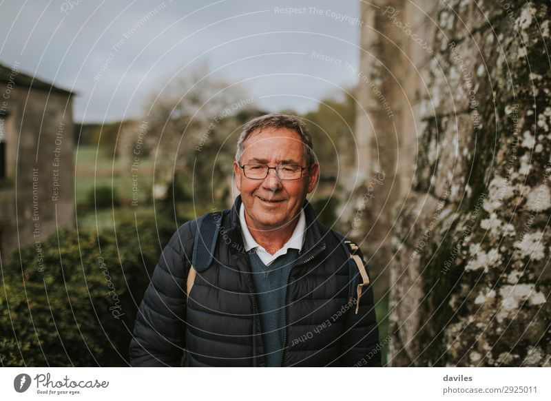 Happy senior man looking at camera Human being Nature Man Old Landscape Joy Winter Mountain Lifestyle Adults Wall (building) Senior citizen Wall (barrier)