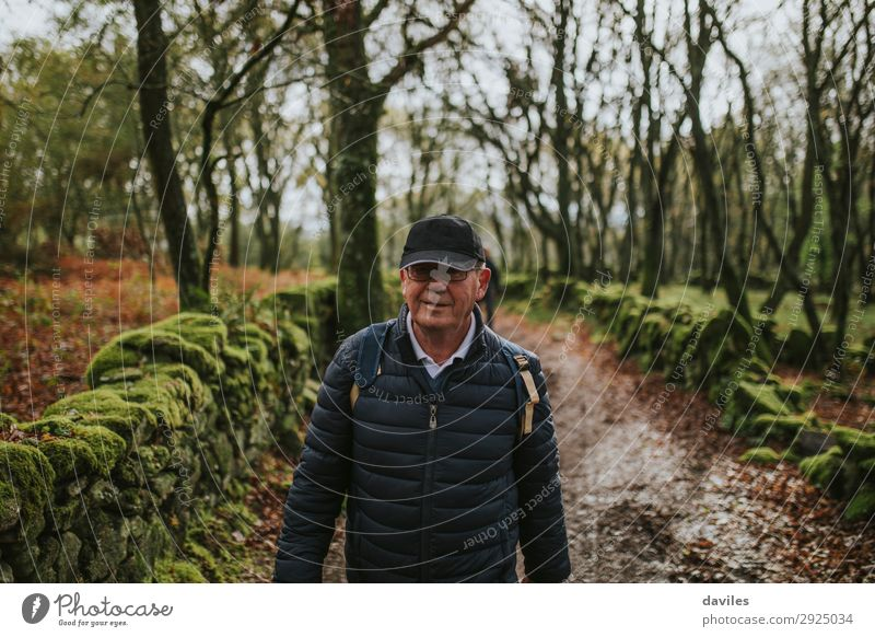 Happy senior man hiking in nature. Vacation & Travel Adventure Hiking Human being Man Adults Male senior 1 60 years and older Senior citizen Nature Landscape