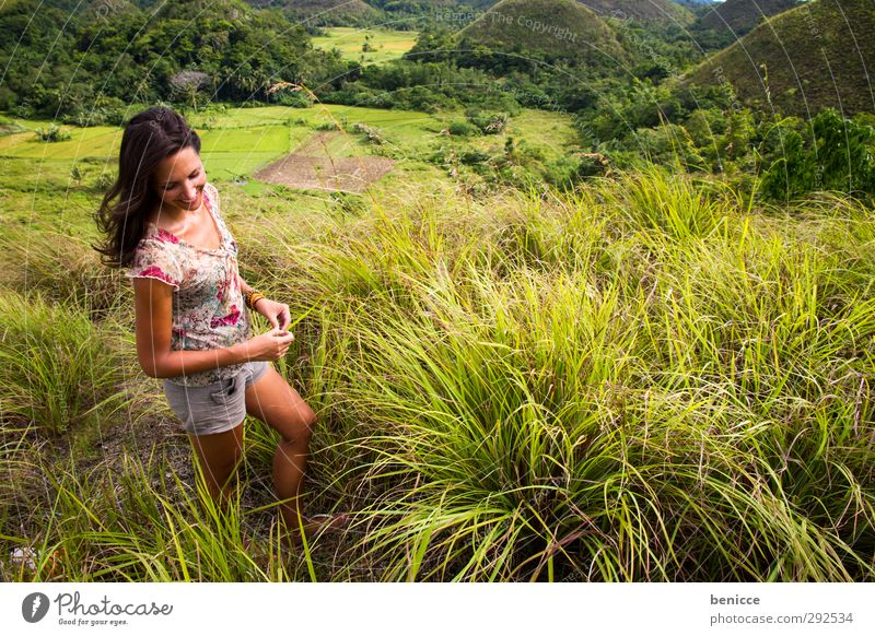 Grass and wind Woman Human being To enjoy Stand Common Reed Meadow Summer Asia Hill Mountain Laughter Smiling Free Freedom Vacation & Travel Longing Loneliness