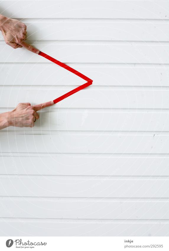 Human being White Hand Red Wall (building) Life Playing Lanes & trails Wall (barrier) Line Facade Leisure and hobbies Communicate Corner Point Sign