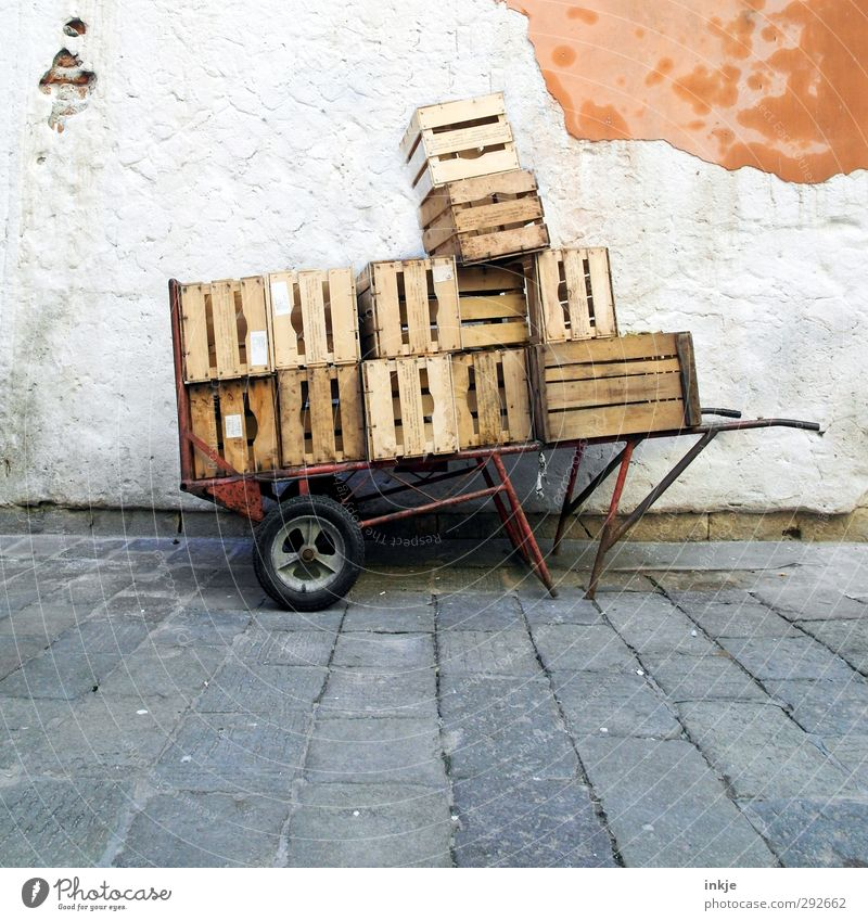 Full load Venice Fishing village Deserted Marketplace Wall (barrier) Wall (building) Facade Wheelbarrow Box Stone Concrete Wood Old Poverty Tall Effort Stress
