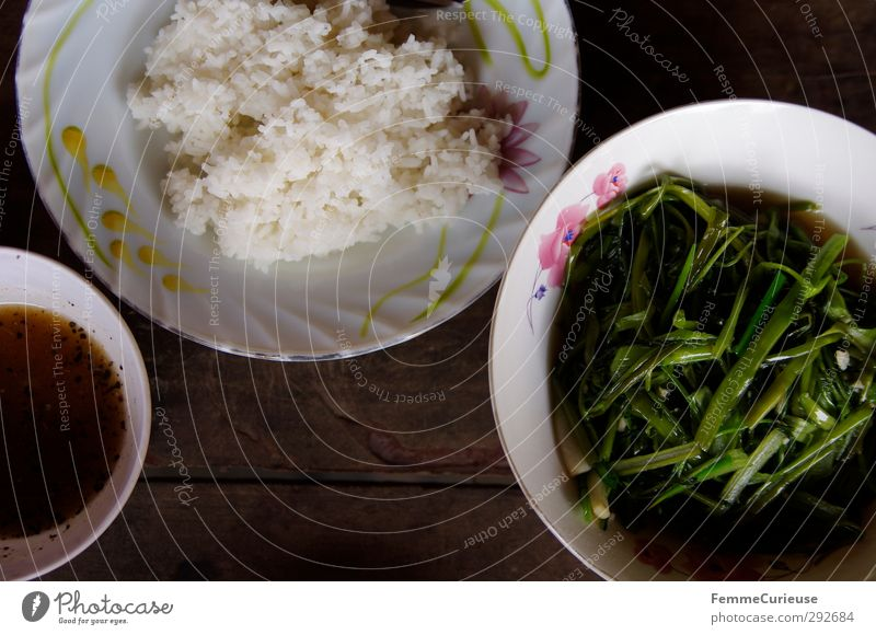 Cambodian Morning Glory. Food Meat Nutrition Eating Lunch Dinner morning glory Rice fish stock fish sauce Spicy Crockery Bowl Painted Wooden table Vegetable