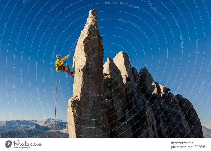Rock climber rappelling. Human being Man Relaxation Adults Adventure Rope Peak Climbing Trust Brave Balance Remote Grasp Mountaineering Self-confident