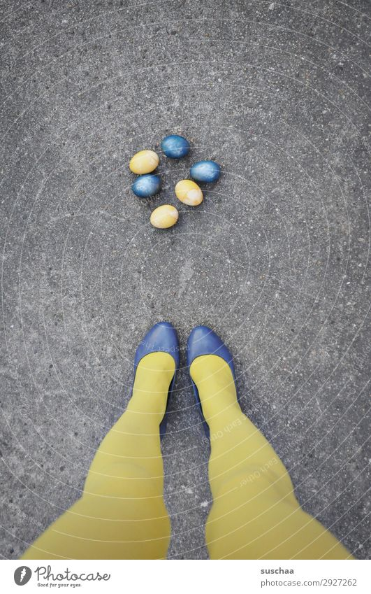 Easter blue/yellow Easter egg Egg boiled eggs colorful eggs Yellow Blue Legs feminine Woman Stockings feet Street Asphalt Strange Whimsical Funny