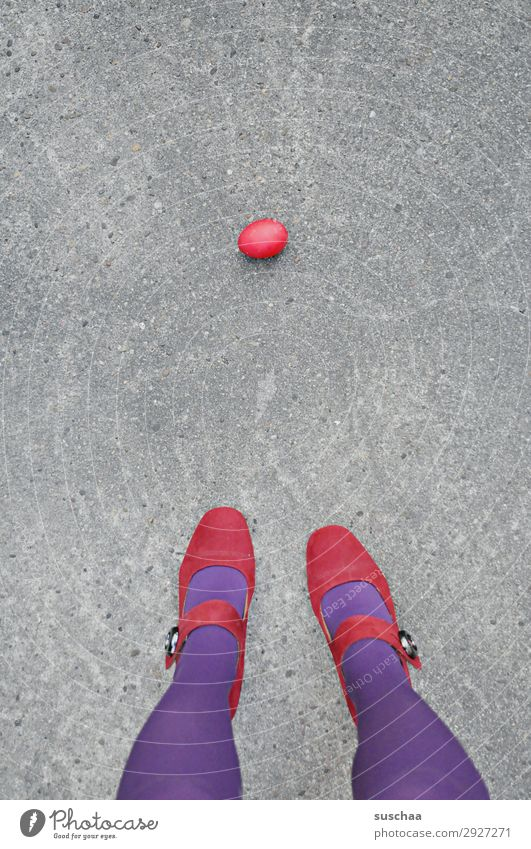 a red easter egg Easter Easter egg Red Individual Egg Street Asphalt Woman Legs Stockings feminine Stand Violet High heels Whimsical Strange