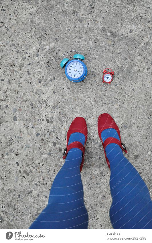 red and blue time Woman Legs Feet High heels Red Blue Street Asphalt Exterior shot Alarm clock Clock Time Haste timing instrument Morning Midday Evening
