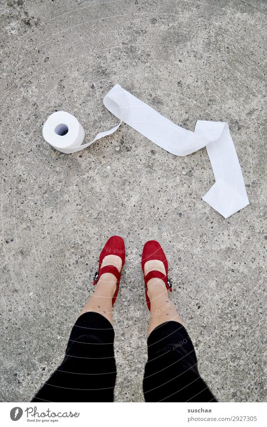 woman in the street with a roll of toilet paper Legs feet Woman Stand feminine High heels Street Asphalt Toilet paper toilet visit Priority Urgent Needs Clean