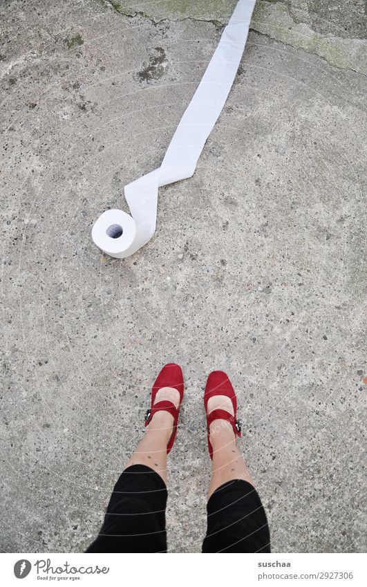 a roll of toilet paper and legs of a woman Legs feet Woman Stand feminine High heels Street Asphalt Toilet paper toilet visit Priority Urgent Needs Clean
