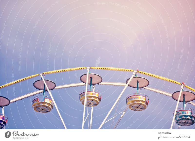 funfair Fairs & Carnivals Downtown Utilize Movement Rotate Driving Flying Free Large Tall Above Round Ferris wheel Feasts & Celebrations Upward Downward