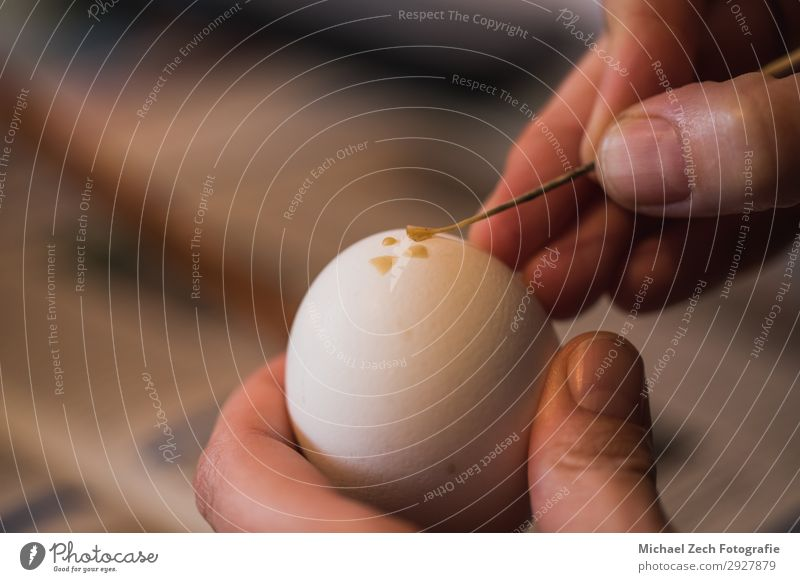 macro shot of woman, handpainting an easter egg with wax Colour Beautiful White Hand Religion and faith Spring Feasts & Celebrations Art Design Decoration