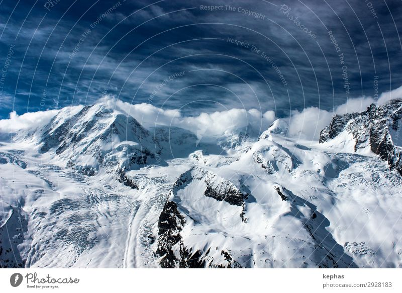 Four thousand meters in clouds Mountain Environment Nature Landscape Elements Sky Clouds Winter Alps Canton Wallis Switzerland Peak Snowcapped peak Glacier