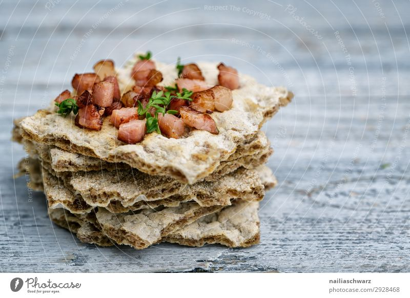 Crispbread with bacon Food Grain Dough Baked goods Bread Herbs and spices Bacon Bacon cube Nutrition Breakfast Lunch Lifestyle Healthy Eating Wooden table