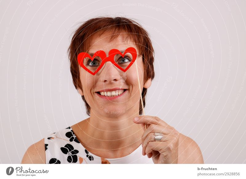 rose-coloured glasses Woman Adults Face 1 Human being 30 - 45 years Eyeglasses Sign Heart To hold on Communicate Smiling Laughter Love Dream Infatuation Romance